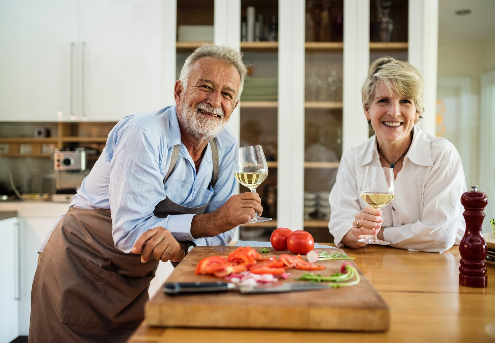 man and woman holding wine glasses